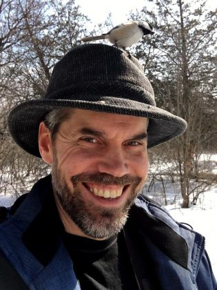 As well as learning to feed chickadees from your hand, you can even put seeds in your hat to attract them, as GreenUP's Leif Einarson demonstrates. (Photo: Leif Einarson)
