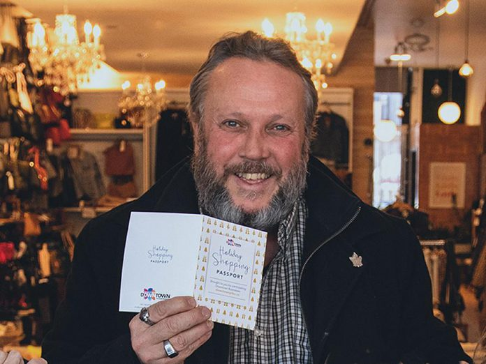 Terry Guiel, executive director of the Peterborough Downtown Business Improvement Area, shows off a Holiday Shopping Passport during the launch of the 2019 program, which encouraged shoppers to spend more than $2.3 million at local businesses in downtown Peterborough. (Photo courtesy of Peterborough DBIA)