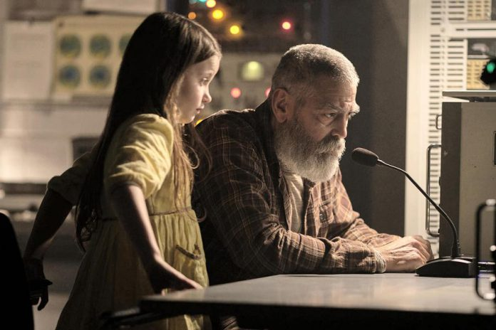 """George Clooney directs and stars as Augustine in """"The Midnight Sky"""", a science-fiction film about a brilliant and aging astronomer in the Arctic who works to stop a team of astronauts from returning home after Earth suffers a mysterious global catastrophe. ALso pictured is Caoilinn Springall as Iris, the mysterious child Augustine encounters at his remote outpost. (Photo: Netflix)"""