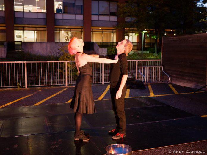 """Kate Story and Ryan Kerr perform """"Love in the Time of Covid"""" in the parking lot behind The Theatre On King in downtown Peterborough in early October 2020. The small not-for-profit black-box theatre, which has been closed since the pandemic began, is raising funds to make it through the pandemic with the support of local businesses along with Public Energy Performing Arts. (Photo: Andy Carroll)"""