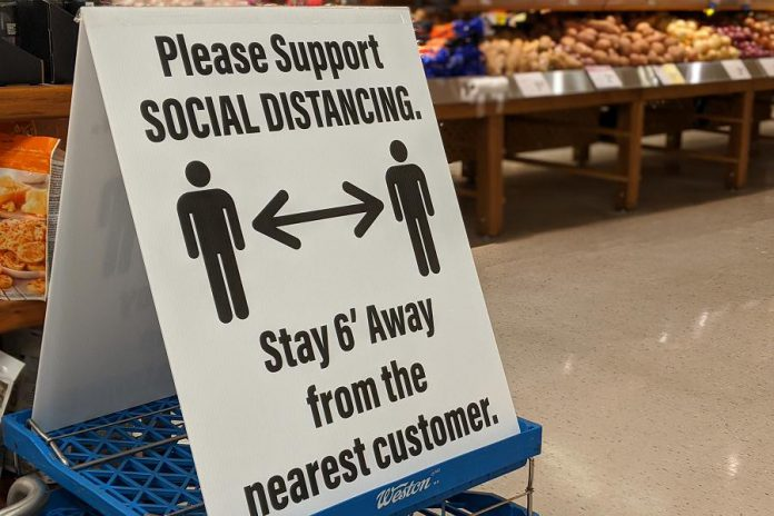 Physical distancing signs at Morello's Independent Grocer in Peterborough. (Photo: Bruce Head / kawarthaNOW.com)