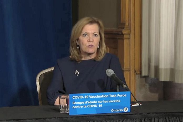 Health minister Christine Elliott responds to a reporter's question about the record increase of 2,275 new COVID-19 cases in Ontario during a media briefing at Queen's Park on December 15, 2020. (CPAC screenshot)