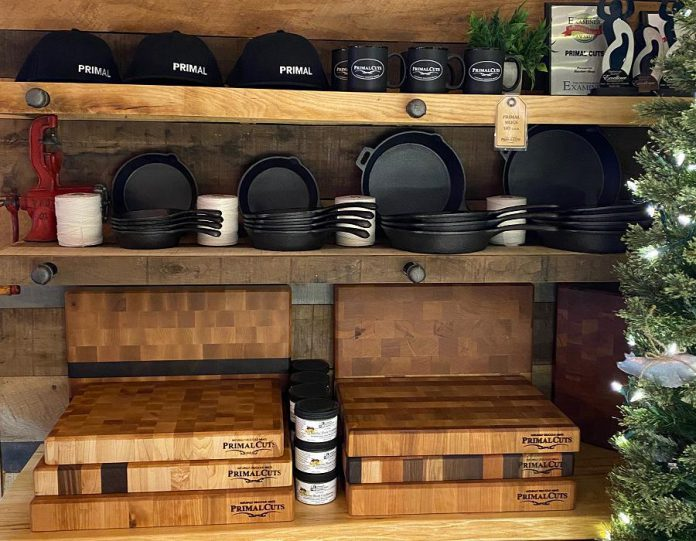 Along with meat, seafood, and prepared food, Primal Cuts offers branded clothing and accessories, cutting boards, Charcuterie boards, grilling planks, and more. (Photo courtesy of Primal Cuts)