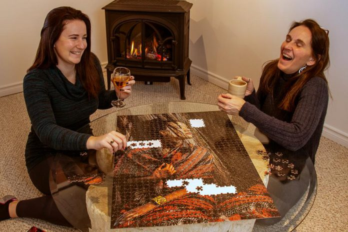 PuzzQuest founder and owner George Gill recently tasked his own family to complete the expert-level 1,000-piece Conformity puzzle to test the degree of difficulty and enjoyment level. (Photo courtesy of PuzzQuest)