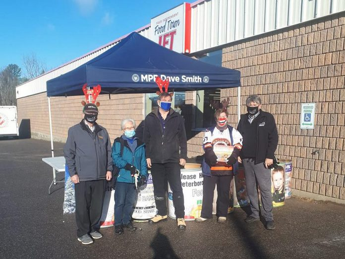 North Kawartha mayor Carolyn Amyotte (second from right) with Peterborough-Kawartha MPP Dave Smith (middle) during a food drive at Sayers Foods on November 28, 2020, which raised more than $21,000 worth of food for North Kawartha Food Bank, located right across the street. Some Apsley residents may be relying on the food bank in the short term now that fire has destroyed Sayers Foods, the only grocery store in the Apsley area. (Photo: Dave Smith / Facebook)