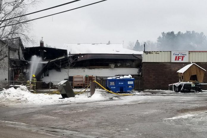 Members of the North Kawartha Fire Department continue to extinguish a fire at Sayers Foods in Apsley that happened early in the morning of December 5, 2020. The building was severely damaged in the fire and will need to be demolished, according to North Kawartha mayor Carolyn Amyotte. Until Sayers Food is able to rebuild, residents of the village of Apsley and the surrounding area will need to travel to Bancroft for groceries. (Photo: OPP)