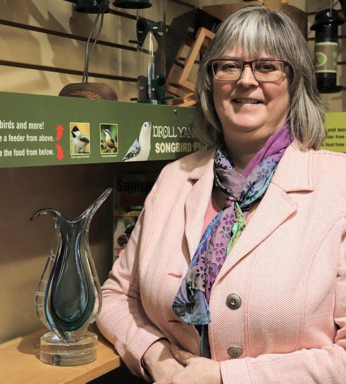 Brenda Ibey, owner of The Avant-Garden Shop in downtown Peterborough, with her 2021 Wild Bird Store of the Year from Newmarket-based Wild Bird Trading, the leading supplier to the wild bird industry across Canada. (Supplied photo)