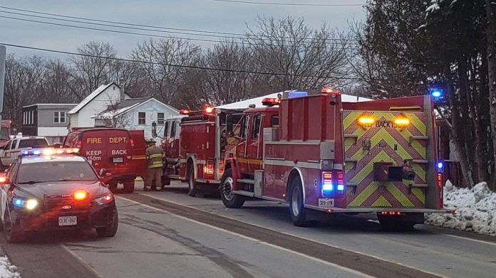 Northumberland OPP and Cramahe Township Fire Department vehicles responding to a house fire in the town of Colborne on January 6, 2021, which claimed the life of a 45-year-old woman. (Photo; OPP)