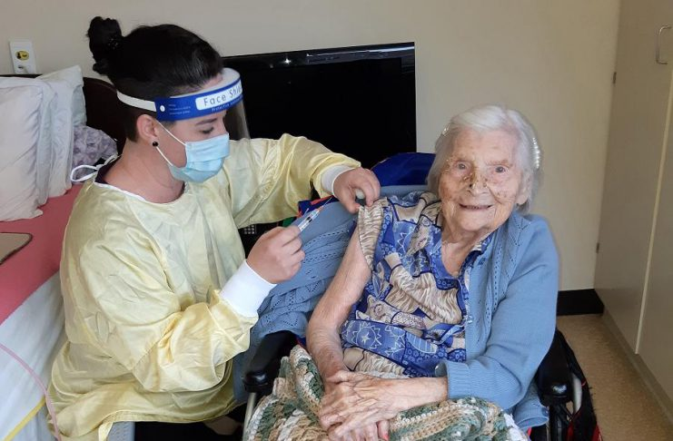 Elizabeth Campbell, a 106-year-old resident at Fairhaven long-term care home in Peterborough, is the first person in the Peterborough area to receive a COVID-19 vaccine. The Moderna vaccine was administered on January 26, 2021 by Lori Rowsell, infection prevention and control practitioner at Fairhaven. (Photo: Peterborough Public Health)