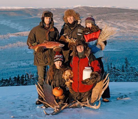 """In summer of 2017, filmmaker Suzanne Crocker (bottom right) and her family started their year-long quest to feed themselves from food gathered, grown, and hunted close to their home in the Yukon. In """"First We Eat"""", which screens at the 2021 ReFrame Film Festival, Crocker explores their journey and the complexity of improving local food security in the far north. (Photo: Alex Hakonson)"""