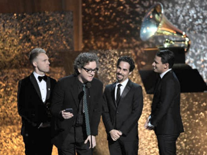 """Greg Wells (second from left) won a Grammy Award in 2019 for his production work on the soundtrack to the film """"The Greatest Showman"""", the best-selling album globally in 2018. (Screenshot via gregwells.net)"""