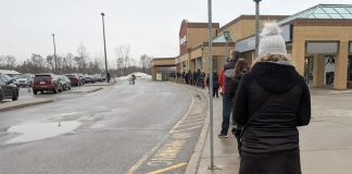 Shoppers line up outside Morello's Your Independent Grocer in Peterborough as the store controls capacity limits as required during the province-wide shutdown. Peterborough Public Health is urging residents to only leave their homes for essential reasons with January on track to see the most cases reported in a monthly period during the pandemic. (Photo: Bruce Head / kawarthaNOW.com)