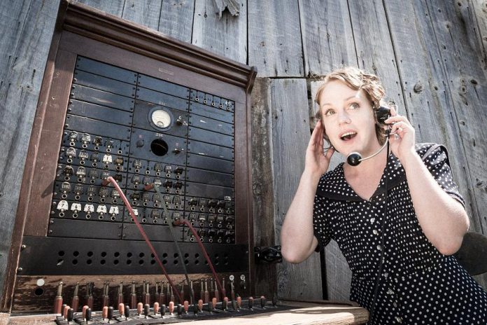 """kawarthaNOW's arts and culture writer Sarah McNeilly performing as switchboard operator Alice Cameron  in 4th Line Theatre's 2018 production """"Crow Hill: The Telephone Play"""", written by Ian McLachlan and Robert Winslow. It was one of the plays comprising 4th Line's Monologue Series in 2020. In this innovative approach to theatrical performance during the pandemic, an actor would call you at no charge to deliver a dramatic reading of one of 27 monologues from 4th Line's archive of plays. (Photo: Wayne Eardley / Brookside Studio)"""