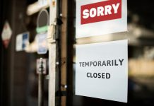 "A ""temporarily closed"" sign on a store window. (Stock photo)"