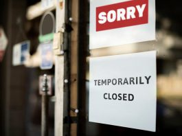 """A """"temporarily closed"""" sign on a store window. (Stock photo)"""