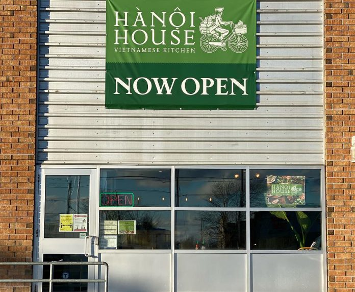 A temporary banner made by Signarama Peterborough hangs at the new second location of Hanoi House at Lansdowne Street West in Peterborough. (Photo courtesy of Hanoi House)