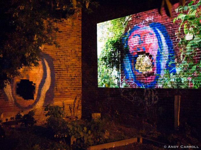 """Peterborough-area artists can now apply for funding for Artsweek SHIFT2, a """"pocket festival"""" of the arts running from March to May in advance of the full Artsweek festival scheduled for fall 2021. Pictured is """"The Door That You Walk Through"""", a film by Daniel Crawford projected onto the side of an abandoned brick building behind The Only Café, during Artsweek 2018. (Photo: Andy Carroll)"""