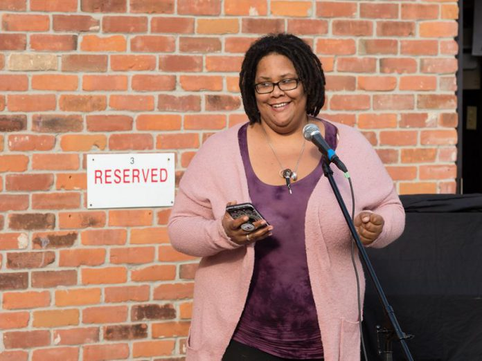 """Poet Elizabeth Jenkins at """"An Afternoon of Spoken Word & Poetry #1"""" on October 24, 2020 in the parking lot of The Theatre on King in downtown Peterborough. The event was part of Artsweek SHIFT: Downtown, curated by poet Justin Million. One component of Artsweek SHIFT<sup>2</sup> will provide funding of up to $1,500 to support artists' creative development and to sustain their art practice. Projects can include public performance but are not required to. (Photo: Andy Carroll)"""