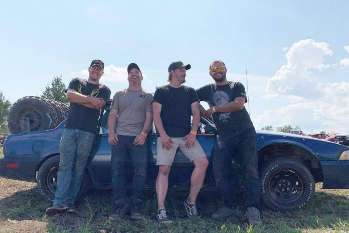 Jeremy Kelly (second from right) and Tyler Junkin, Nate Mitchell, and Andy McCann with kawarthaNOW writer Paul Rellinger's former 1988 Chevrolet Cavalier. (Photo courtesy of Ellisha Tryon)