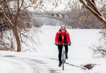 Peterborough is home to many year-round cyclists. For some it is a way to get outside, for others a main mode of travel. Here, Peterborough resident Carol Love rides her bike along the Millennium Trail. (Photo: Vicky Paradisis)