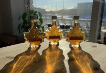 The winter sun shining through bottles of maple syrup at the GreenUP Store in Peterborough. Unless appropriate action is taken to mitigate the impacts of climate change, sugar bushes may no longer be viable in southern Ontario due to drought. (Photo: Kristen LaRocque)