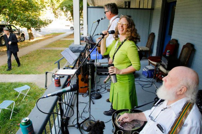 """One of organizer Ken Tuck's ideas for a post-pandemic celebration in Peterborough is having musicians perform on the streets. From 2015 to 2018, Artsweek Peterborough hosted """"Porchapoloza"""", where local musicians played from the porches of homes in different Peterborough neighbourhoods. Pictured are Hank and Kristine Fisher performing during the first Porchapoloza in 2015. (Photo: Artsweek Peterborough)"""
