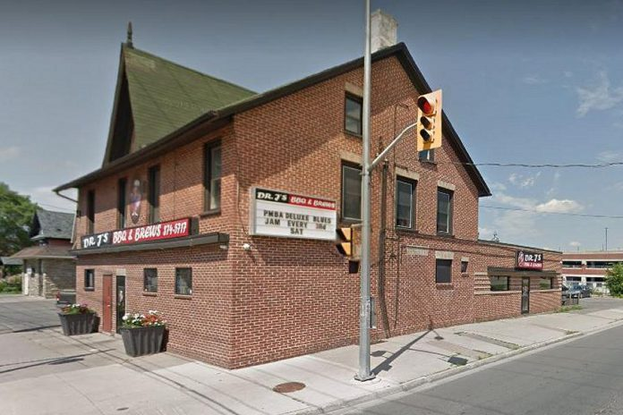 """Located at 282 Aylmer Street, Dr. J's  BBQ & Brews is named after Dr. John Harvey, for whom the original building was built in 1858. The building was sold in 1870 and became a boarding house called """"The Montreal House"""". Before Dr. J's opened in 2014, The Montreal House was a well-known local bar. Pre-pandemic, Dr. J's also hosted the Peterborough Musicians Benevolent Association's monthly Deluxe Blues Jam. (Photo: Google Maps)"""