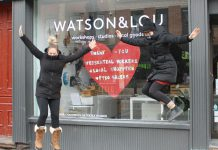 Watson & Lou co-owners Erin Watson and Anna Eidt literally jump for joy after recently reopening the doors of their downtown Peterborough shop to in-person shoppers. Their creative hub, which helps local artists and makers reach a wider audience year-round, continues to also offer online shopping, curbside pickup, and free local delivery. (Photo courtesy of Watson & Lou)