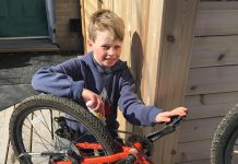 Kye is getting his bike ready for spring, making sure his chain is well oiled and free of damage. Once it's ready, he'll plan his cycling route with his family. Together, they'll make sure it is fun and free of hazards. (Photo: Jackie Donaldson)