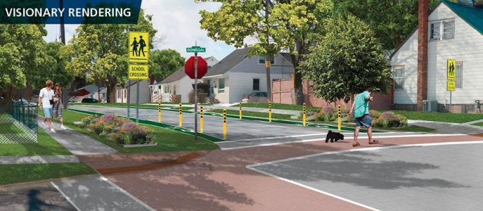As part of GreenUP's NeighbourPLAN Vision for the Jackson Park-Brookdale neighbourhood in Peterborough, this visionary rendering of Wolsely and Donegal shows a stop sign, clearly marked crosswalk, cycling lanes, and gardens in the boulevard. These enhancements to the intersection would make the crossing experience safer for the young families who walk to Highland Heights Public School. (Illustration: Basterfield & Associates for GreenUP)