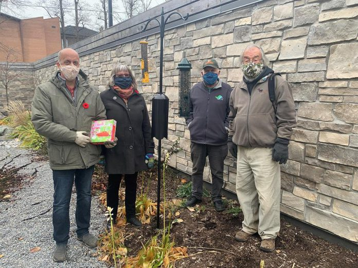 Clayton and Brenda Ibey of The Avant-Garden Shop with King Baker and and Martin Parker of the Peterborough Field Naturalists after installing bird feeders installed at Hospice Peterborough in fall 2020. (Photo courtesy of Hospice Peterborough)