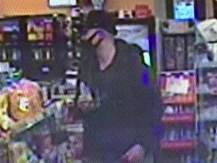 The suspect in a March 3, 2021 robbery of a Lindsay Street South business captured on surveillance footage. (Police-supplied photo)