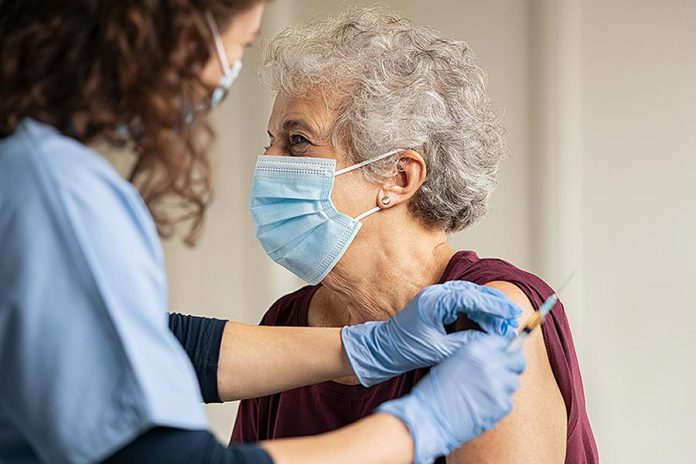 An older woman receiving a COVID-19 vaccination. (Stock photo)