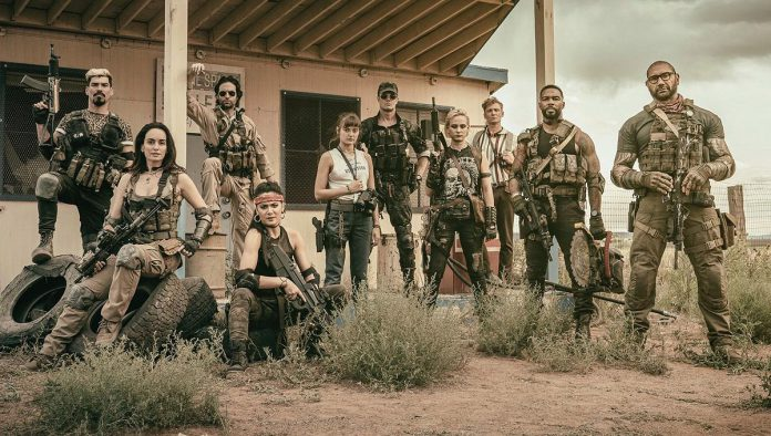 "From filmmaker Zack Snyder, the Netflix zombie heist action flick ""Army of the Dead"" tells the story of a gang of mercenaries attempting to retrieve $200 million from a vault inside zombie-infested Los Vegas, with just 32 hours to go before the government nukes the city. It premieres on May 21, 2021. (Photo: Netflix)"