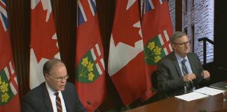 Adalsteinn Brown, co-chair of the Ontario COVID-19 Science Advisory Table, and Dr. David Williams, Ontario's chief medical officer of health, present updated COVID-19 modelling projections at a media briefing on April 16, 2021. (CPAC screenshot)