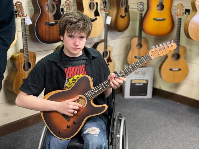 When he's not acting or making music, Christian Rose works at Maar's Music in Peterborough. (Photo: Maar's Music / Facebook)