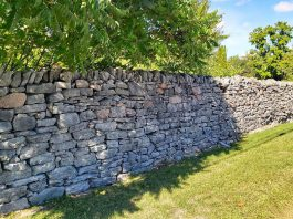 An intact section of the historic Edgewood dry stone wall in Bobcaygeon. A group of Bobcaygeon volunteers are raising funds to restore the 400-foot wall, built in 1891, for its 130th anniversary in 2021. (Photo: Heritage Evaluation Report, September 2020)