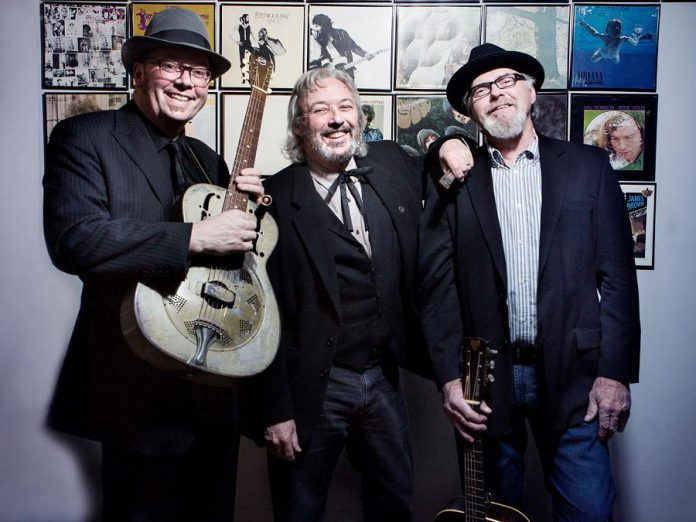 Rick Fines, Al Black, and Gary Peeples of Jackson Delta pictured in 2019. The Peterborough acoustic blues trio will be headlining a PTBOLive drive-in concert at the Peterborough Memorial Centre on August 27, 2021, with Peterborough blues-rock band Emily Burgess & The Emburys opening. (Photo courtesy of SLAB Production)