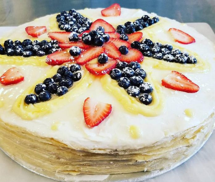 """The Crepes of Wrath's crepe mille feuille cake features 20 crepes layered with mascarpone and lemon curd and topped with fresh berries. It measures a full 16"""" diameter and is 4"""" high. (Photo: Crepes of Wrath)"""