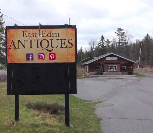 East of Eden Antiques has sold its property and buildings, located on Highway 28 at Woodview, to Kawartha Adventure Rentals. As part of the deal, Brenda Mahaffy's antique shop will continue to operate out of the white church on the property. (Screenshot from Facebook video by kawarthaNOW)
