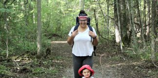 GreenUP program coordinator Sara Crouthers, pictured enjoying a hike with her son at Sibbald Point Provincial Park, explains that the traumatic injustices faced by the world's Black people, Indigenous people, and people of colour also extend to the environmental movement. (Photo courtesy of Sara Crouthers)