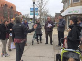 It's better for students' health and the environment if they have active transportation options when they head back for in-person learning in the fall. Pictured are parents, guardians, teachers, school staff, and other community members in May 2019 during a walkabout of the Immaculate Conception School area in Peterborough's East City, an important opportunity to hear directly from community experts about active school travel challenges and opportunities. (Photo courtesy of GreenUP)