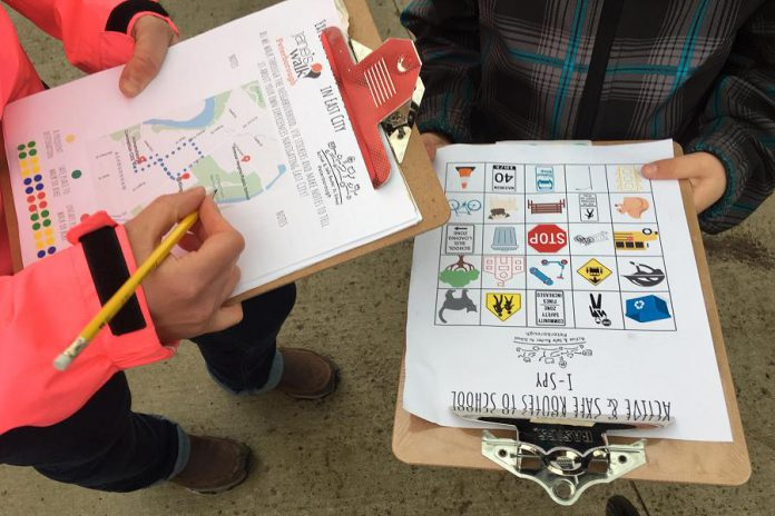 """Students work on an """"I Spy"""" activity in May 2019, designed to assist them with navigating Peterborough East City neighbourhood, during a Jane's Walk event planned in partnership with Active School Travel Peterborough. (Photo courtesy of GreenUP)"""