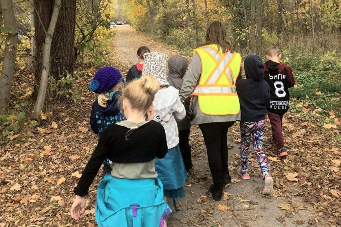 Students from the former King George Public School enjoy a walk on a local trail in October 2019. King George and Armour Heights public schools are being replaced by the new Kaawaate East City School, scheduled to open September 2021.  (Photo courtesy of GreenUP)