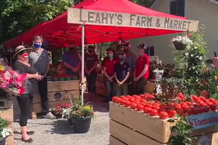 During the launch of the new Leahy's Farm & Market in Apsley on June 4, 2021, North Kawartha Mayor Carolyn Amyotte (far left) thanked Peterborough-Kawartha MPP Dave Smith (second from left) for the delivery of 3,000 pounds of food and $1,250 in cash donations and gift cards for the North Kawartha Food Bank, raised earlier in the day at Morello's Your Independent Grocer in Peterborough. Leahy's Farm & Market is a partnership between the Leahy family, Ball Real Estate, and Calm N Ground. (Screenshot of Facebook video by Ball Real Estate)