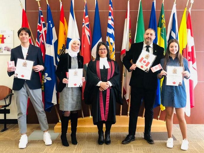 Imad Mahfouz (second from right) came to Canada in 2015 with his family (son Abdullah, wife Nerveen, and daughter Zeina) to escape the war in Syria and settled in Peterborough. The family of four obtained their Canadian citizenship in 2020. Imad, who loves cooking, was a restaurateur in Syria and plans to open a restaurant in his new home community of Peterborough. (Photo courtesy of the Mahfouz family)