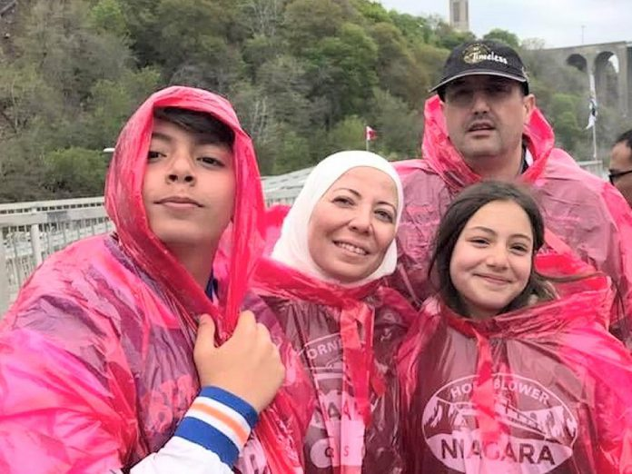 Imad Mahfouz with his family during a pre-pandemic trip to Niagara Falls. After arriving in Peterborough from Syria, the family received help getting settled from the New Canadians Centre Peterborough and now, after six years, feels a sense of home and belonging in Canada. (Photo courtesy of the Mahfouz family)