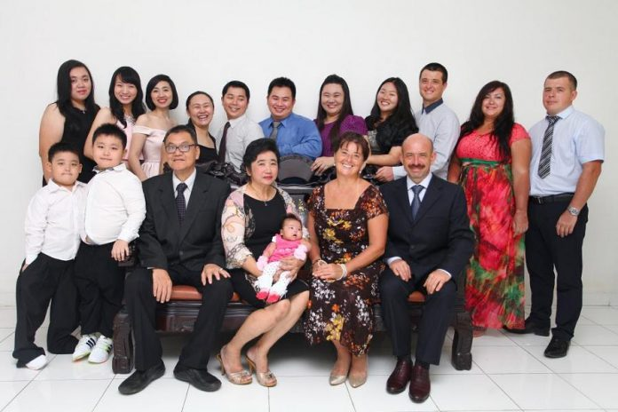 Jessie and her husband Dmitry are truly an international Canadian couple, as shown in this pre-pandemic photo of their families. Jessie's family live in Indonesia and Dmitry's family lives in Russia. (Photo courtesy of Jessie Iriwanto)