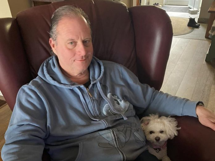 Peter Blodgett, owner of Darling Insurance, with Lexie. Although Blodgett is allergic to all animals, he has donated $100,000 towards the construction of the Peterborough Humane Society's new animal care centre. (Supplied photo)