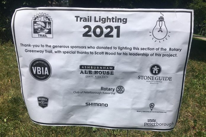 This mock-up of the embossed metal plaque that will recognize sponsors' contributions to the lighting of Rotary Greenway Trail from Hunter Street East to Douro Street was on display at an update on the project held June 22, 2021.  (Photo: Paul Rellinger / kawarthaNOW)
